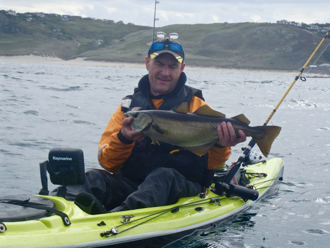 Kevin with a Pollack on his Jensen at the Penzance Kayak Fishing Meet 2015