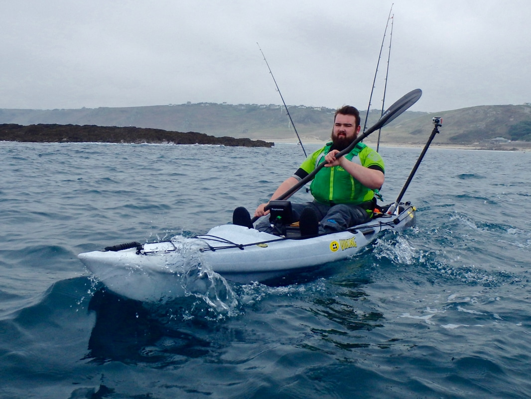 Andrew paddling the Viking Pro Fish Reload fishing kayak