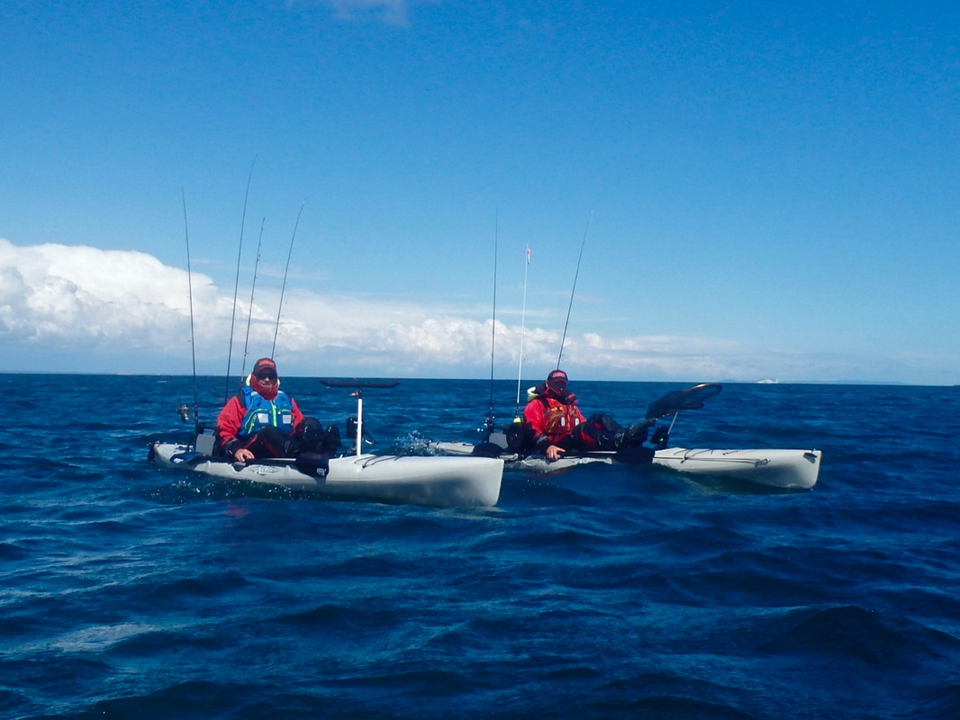 Ben and Martin on their Hobie Revo 16's
