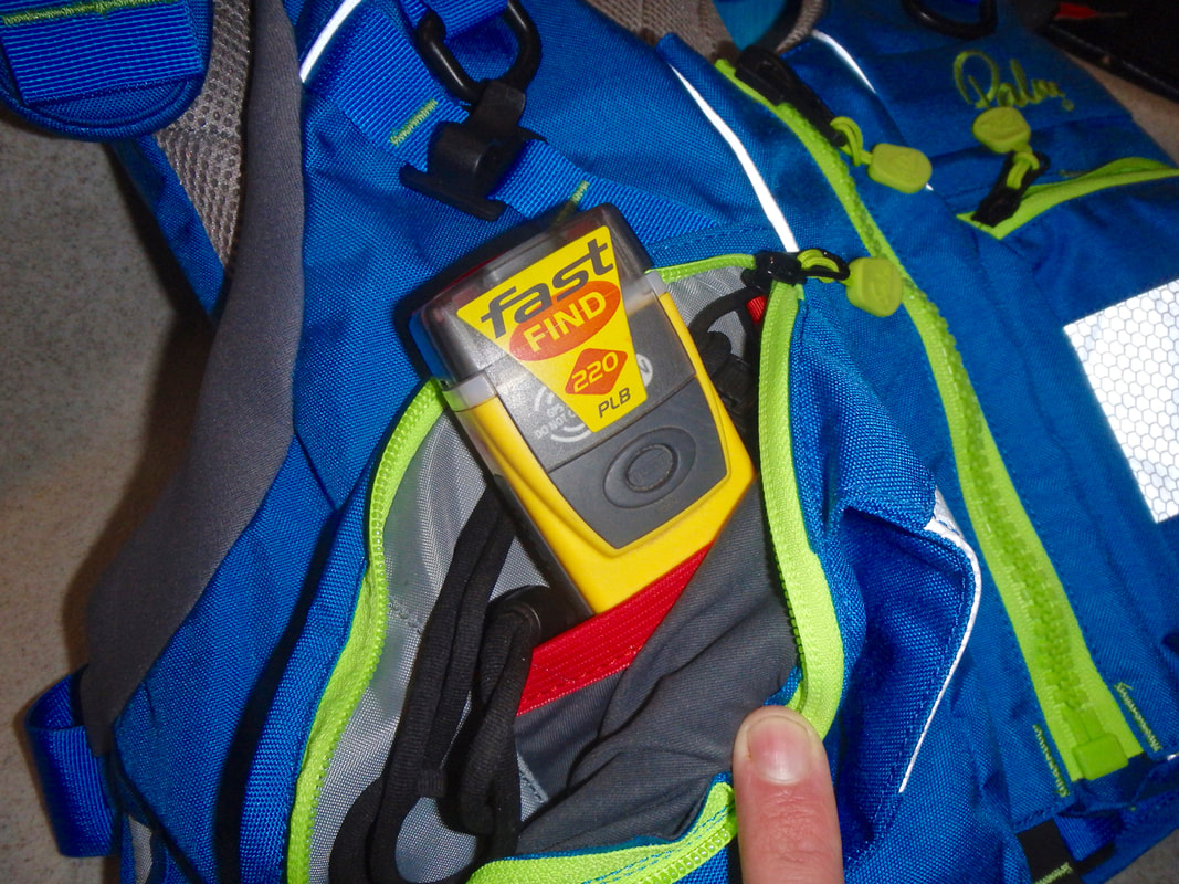 A PLB personal location beacon in a buoyancy aid pocket