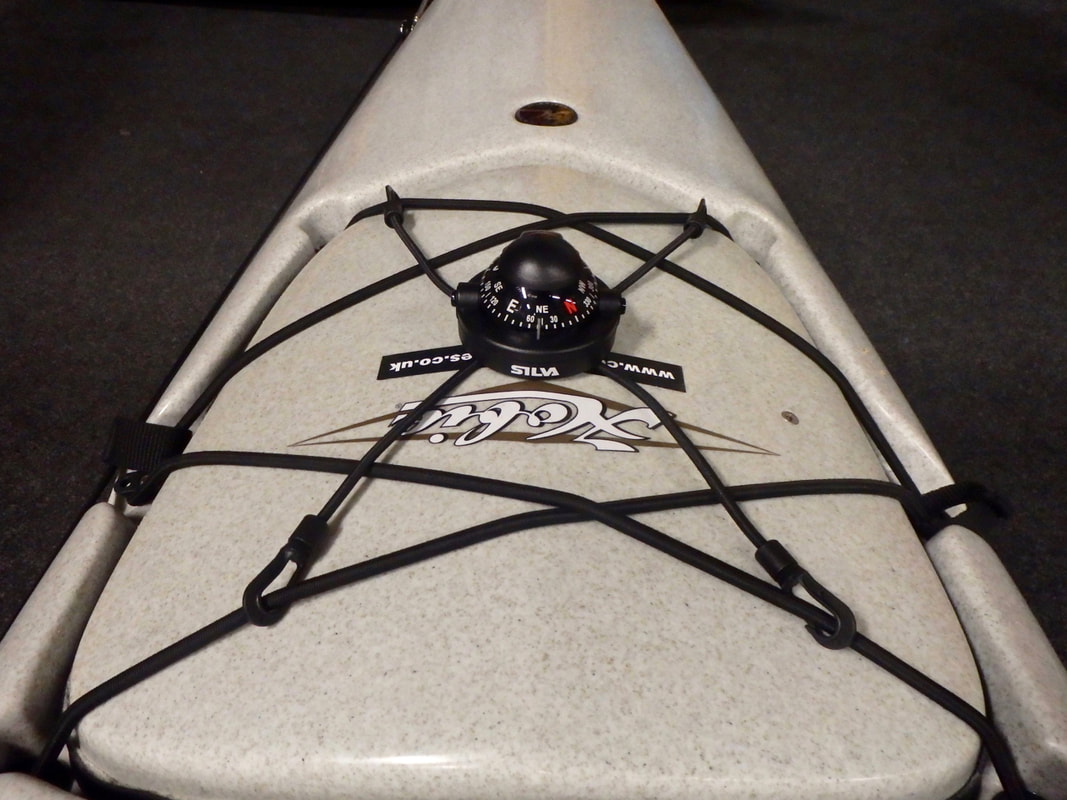 A Silva Kayak Compass installed on the bow of a fishing kayak