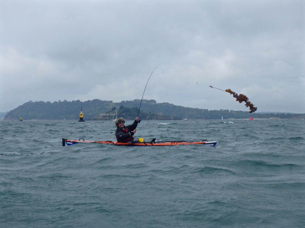 Amos with a monster from the deep during the Ocean Kayak Classic 2015