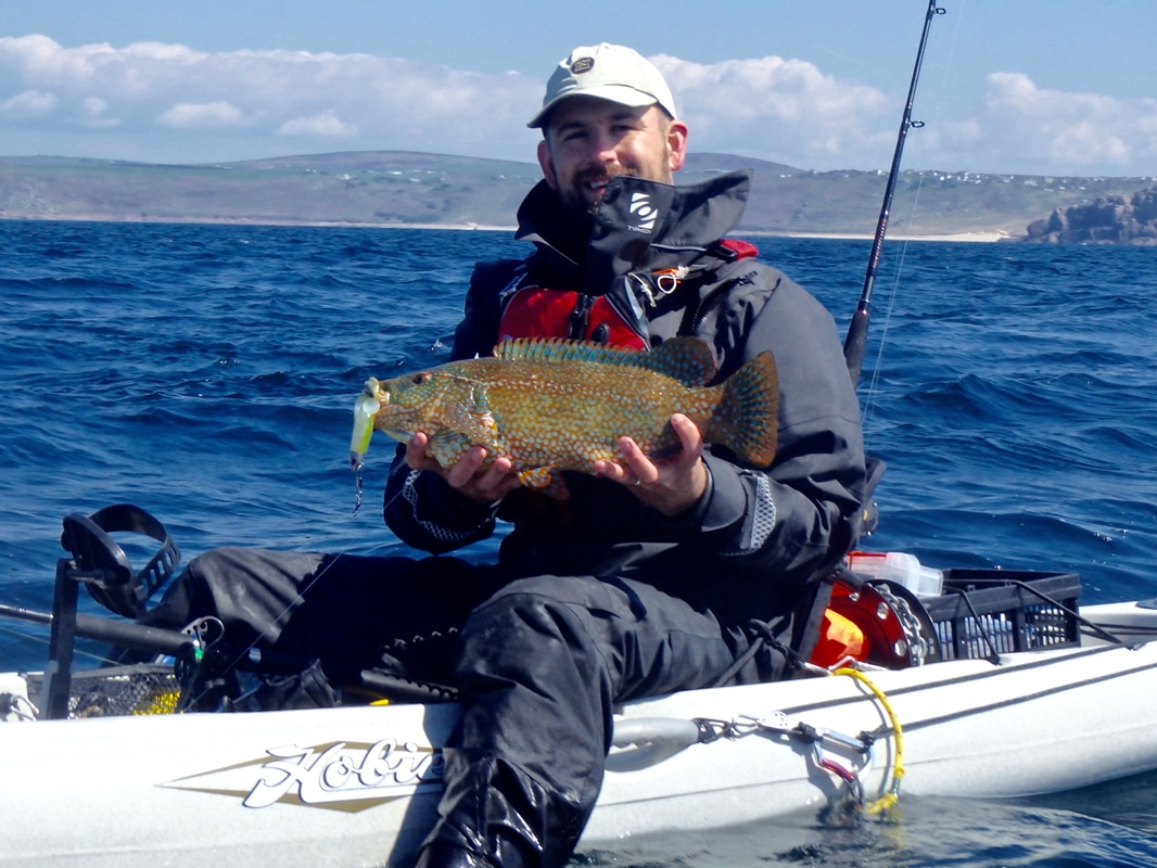 Adam with a nice Ballan Wrasse on the Revo 16