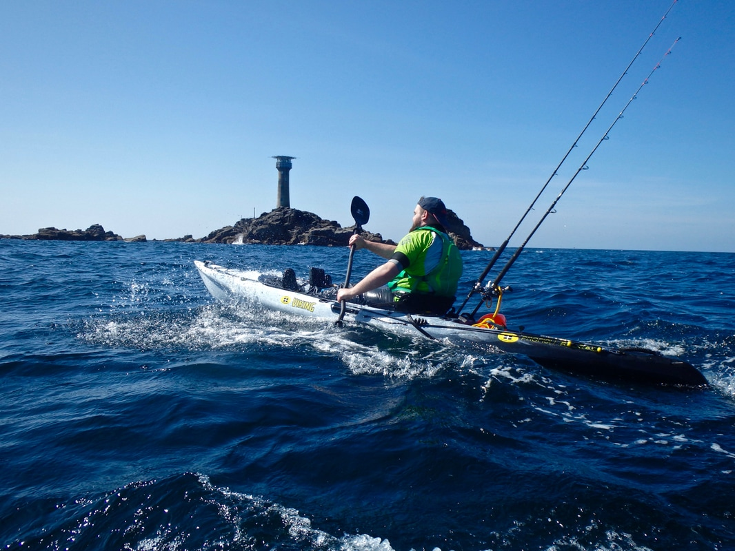 Andrew Paddling out to Longships Lighthouse on the Viking Profish Reload