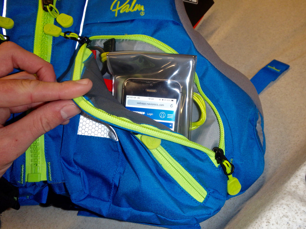 A mobile phone in an aquapac fits in a Palm Kaikoura PFD