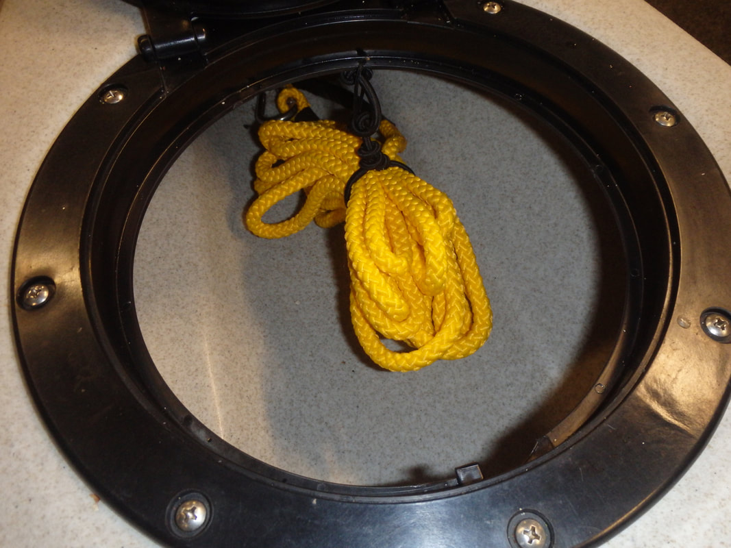 Home made towline stored in kayak hatch